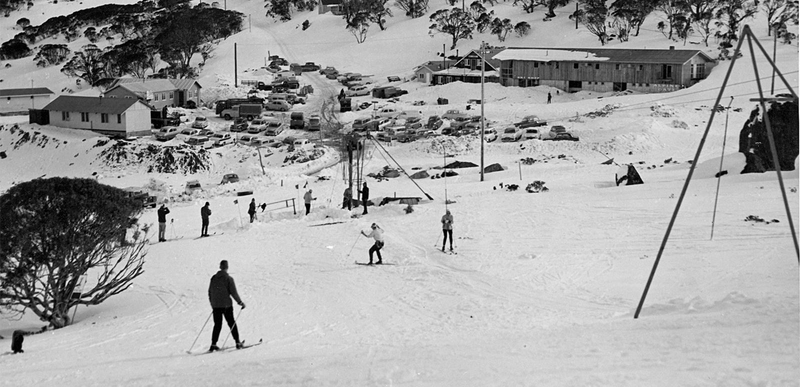 Skiers skiing down a slope in the early 1960s