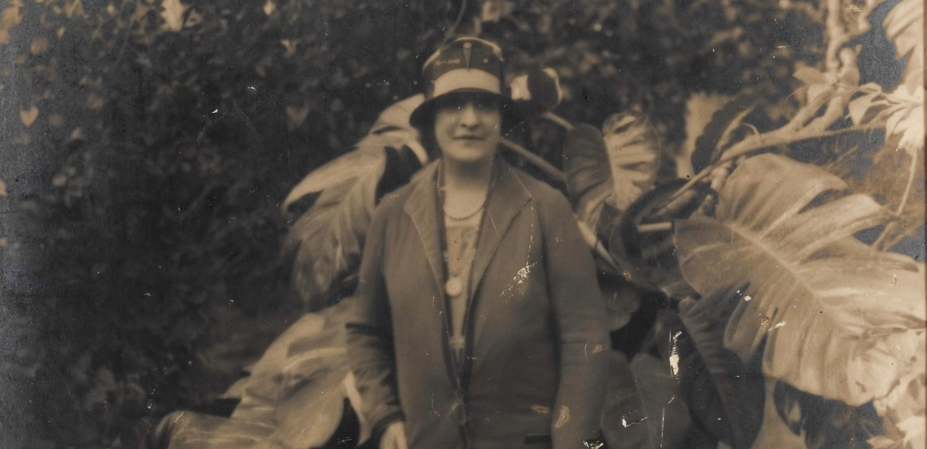 Sepia photograph of Dame Nellie Melba in a garden
