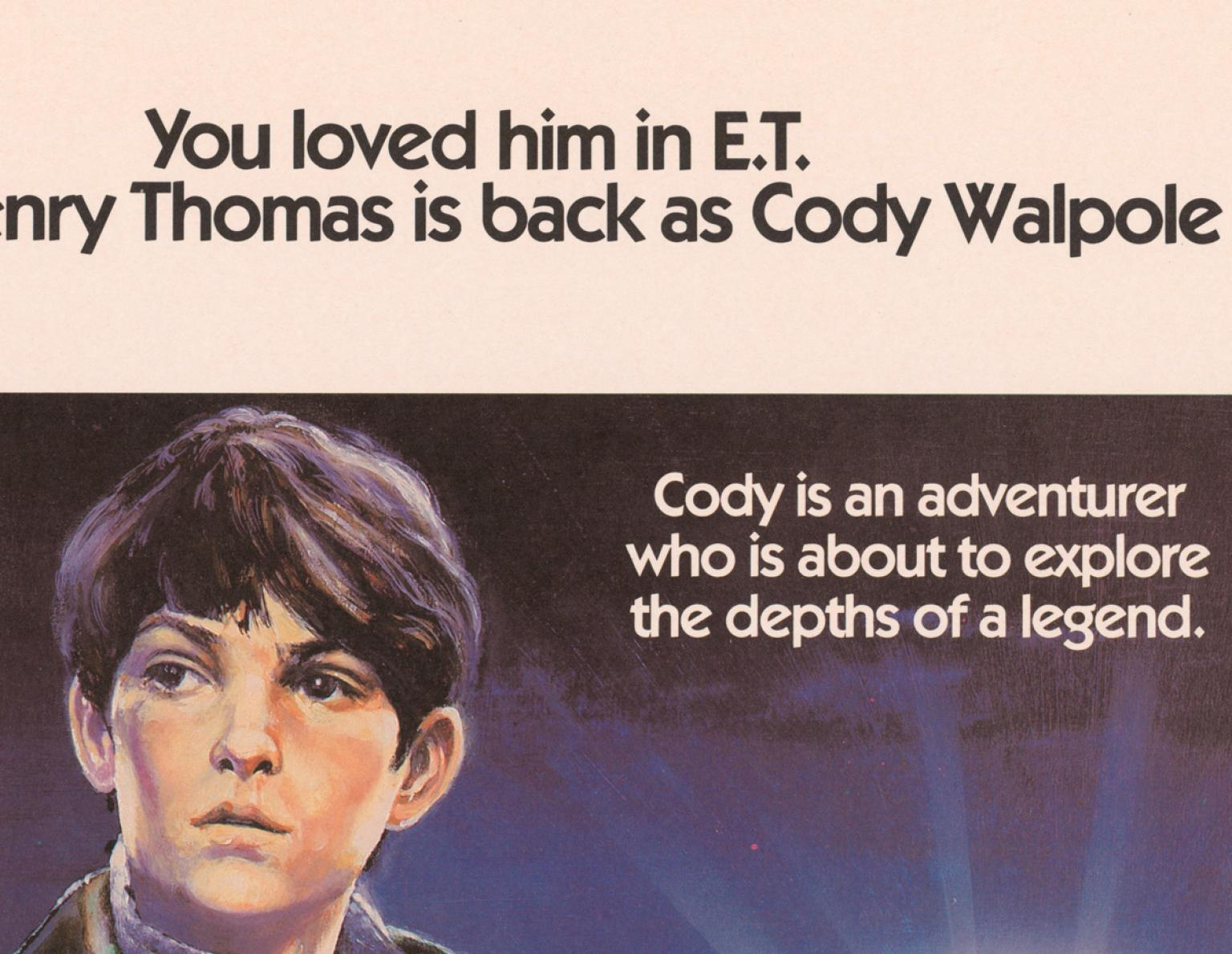 Close up of a young boy's face. Writing above his head says 'You loved him in E.T. Henry Thomas is back as Cody Walpole.' Writing at the side says 'Cody is an adventurer who is about to explore the depths of a legend'.