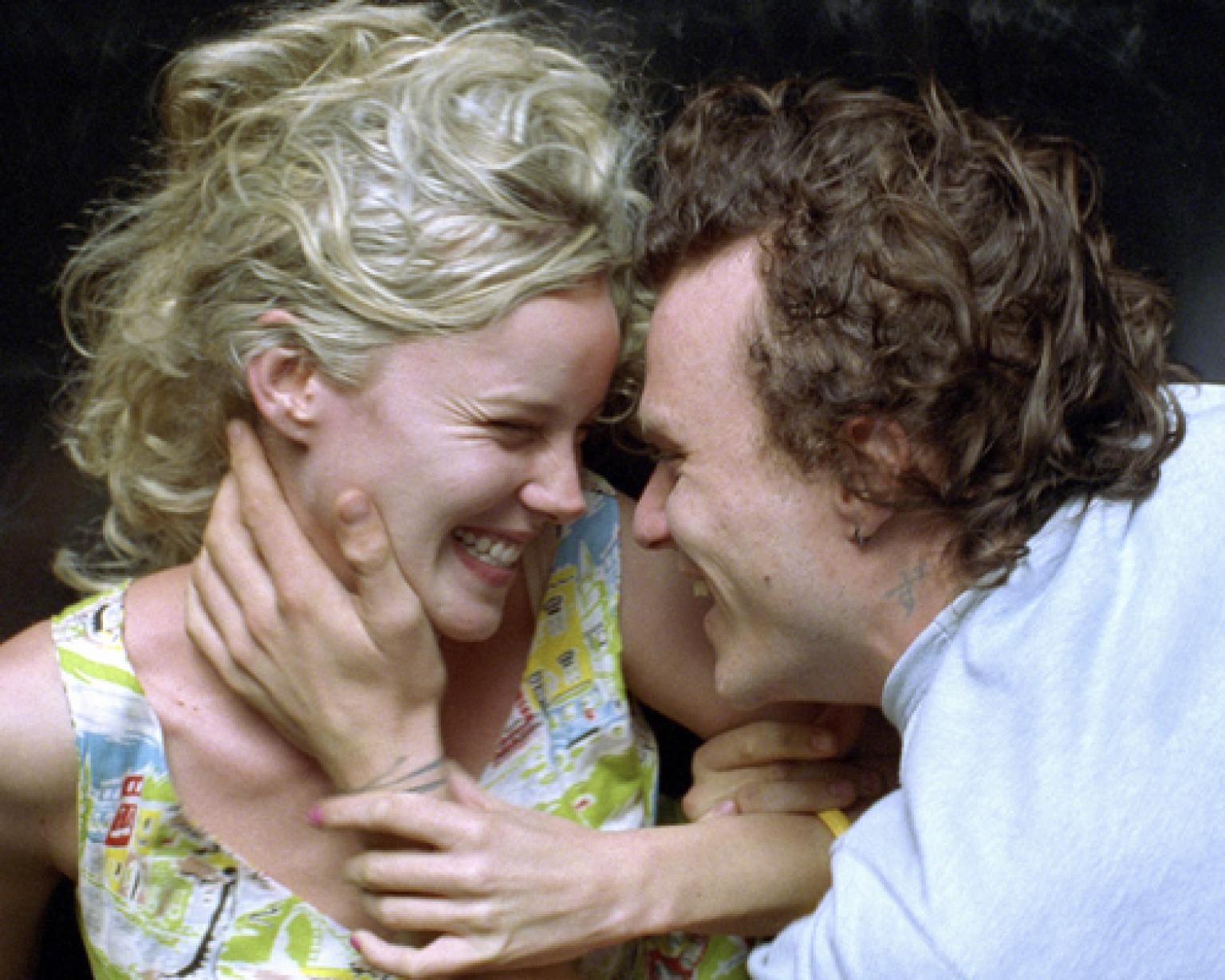 Abbie Cornish as Candy and Heath Ledger as Dan smiling at each other and in an embrace.