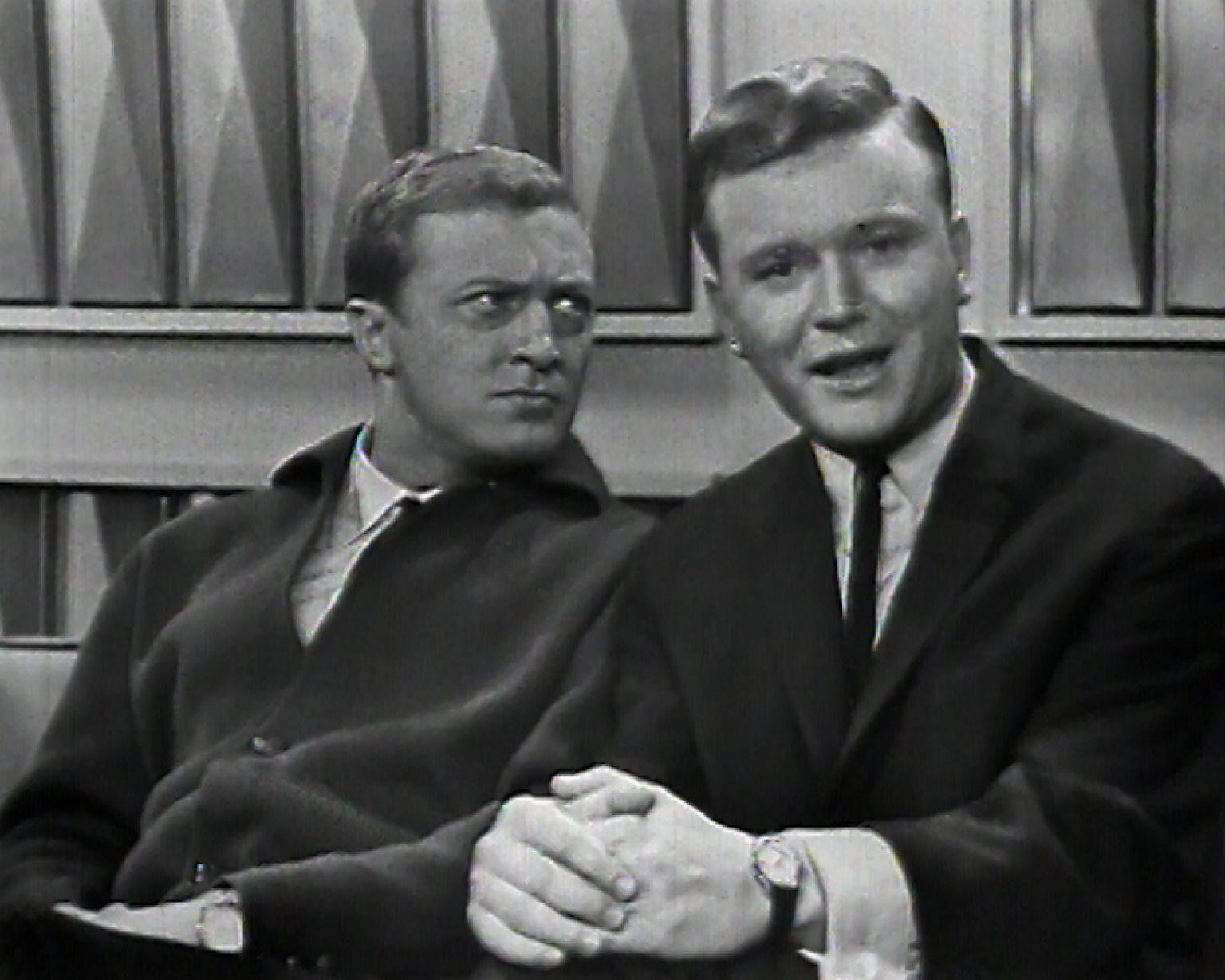 Graham Kennedy looking at Bert Newton who is looking into camera