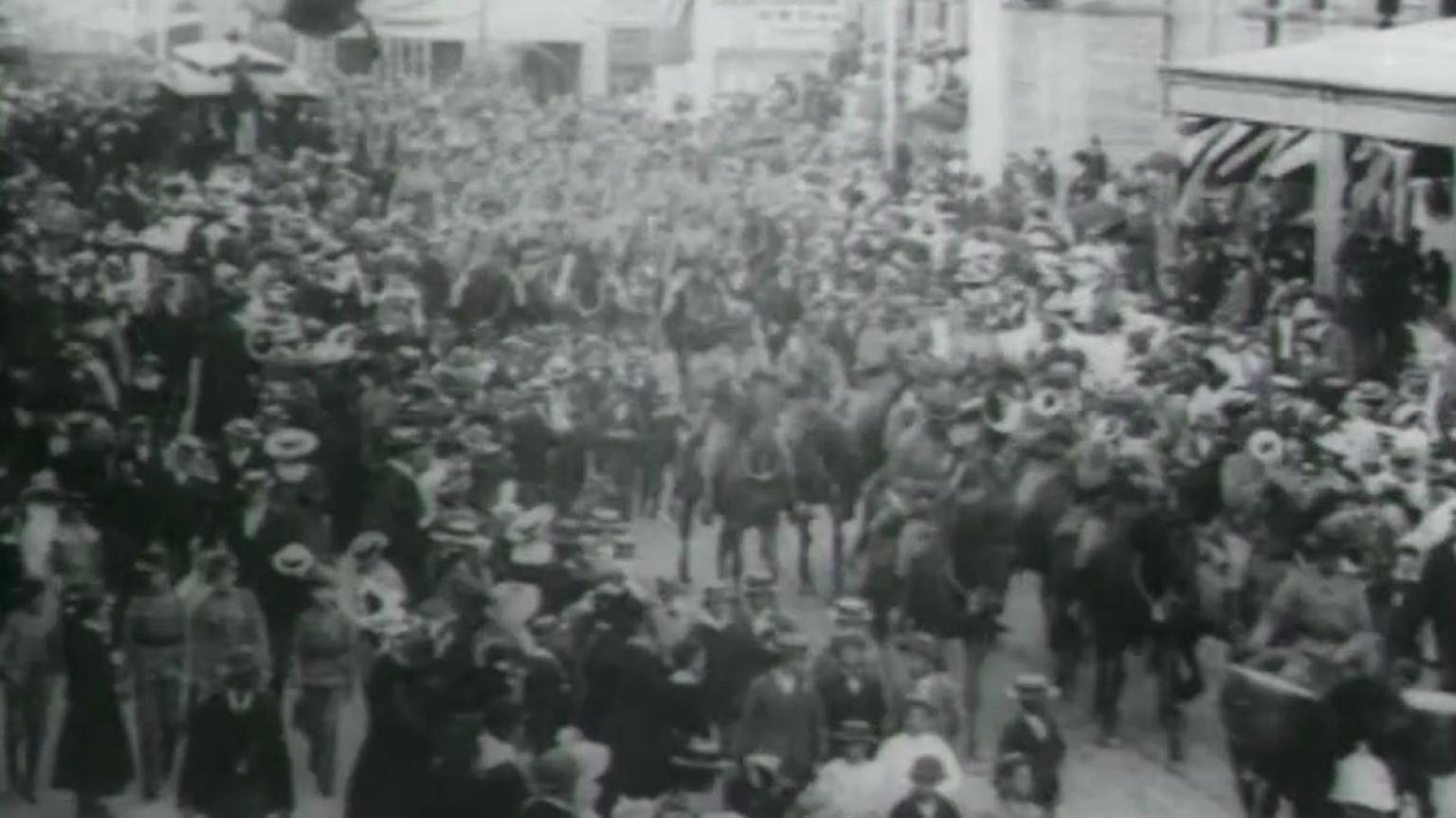 Crowds in Queen Street, Brisbane, watch the First Queensland Cavalry Contingent parade before it departs for the Boer War in South Africa.