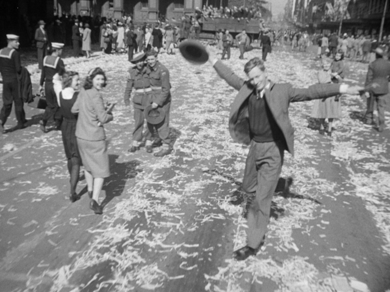 A man dances in the street to celebrate the end of the Second World War