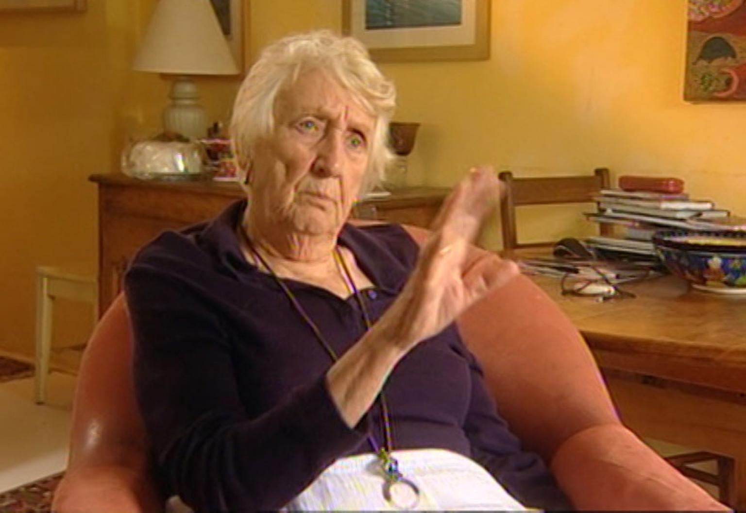 Moya Wood seated at home being interviewed