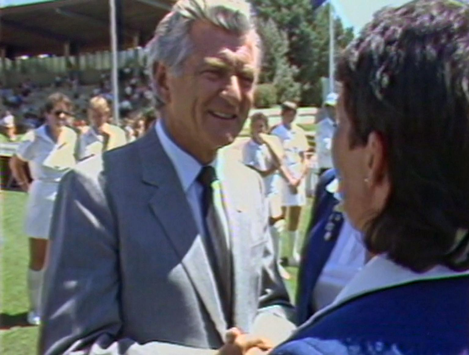 Prime Minister Bob Hawke greets a member of the England Women's cricket team in 1985 in Canberra.