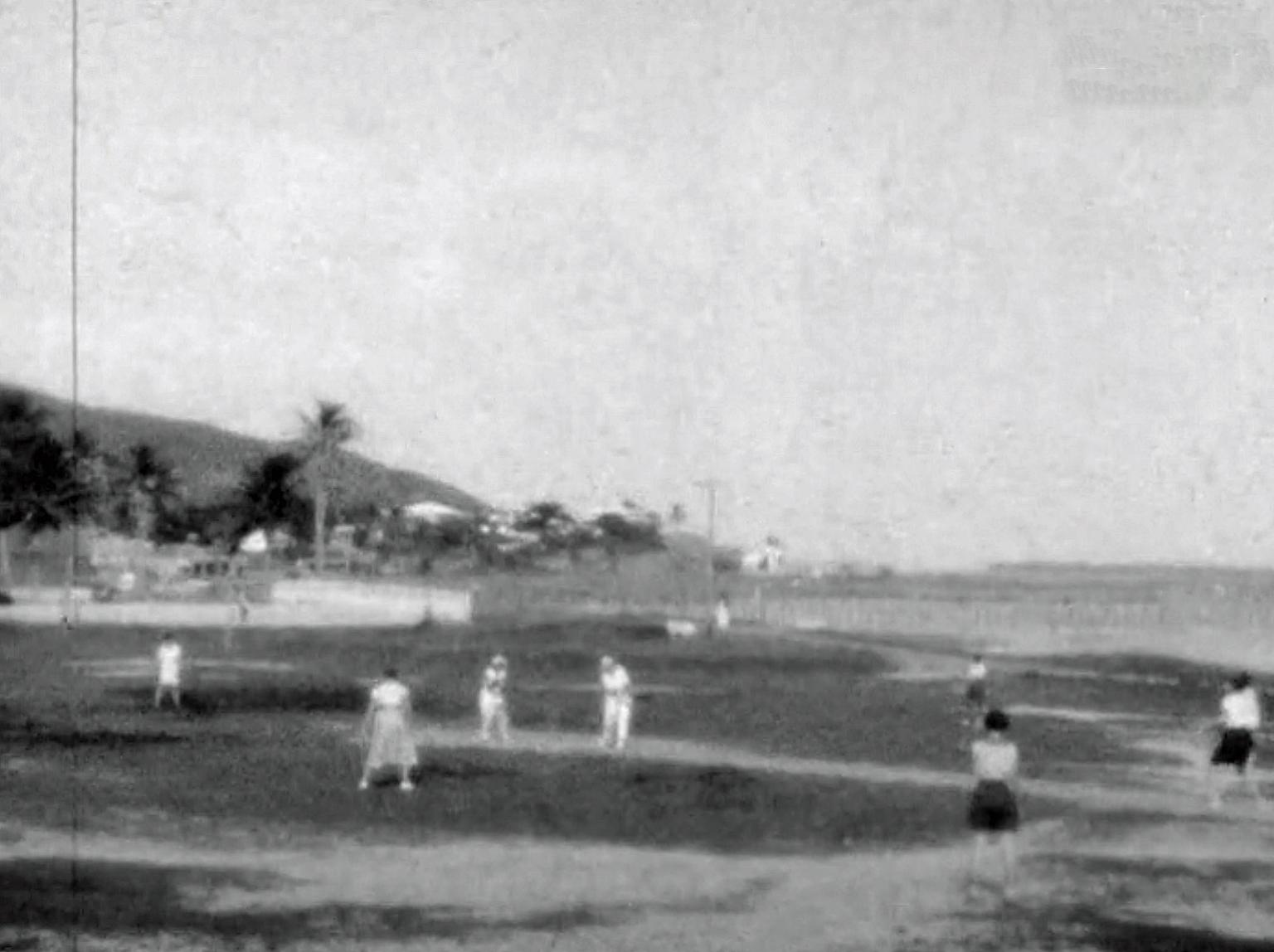 A grainy black and white still image from a 1933 home movie of some women playing cricket on Thursday Island in the Torres Strait.