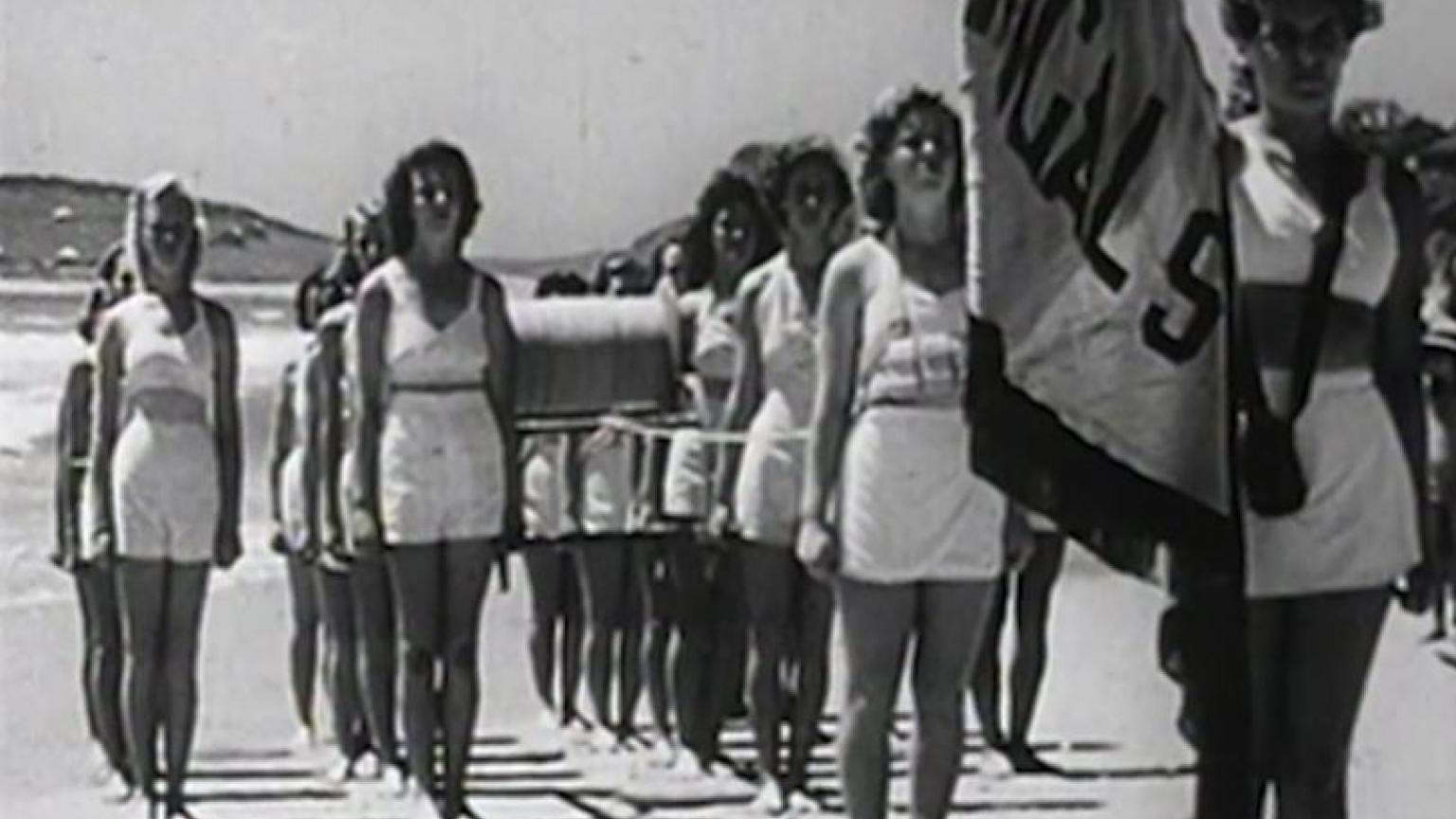 Female lifesavers from Terrigal Surf Life Saving Club participate in a march past
