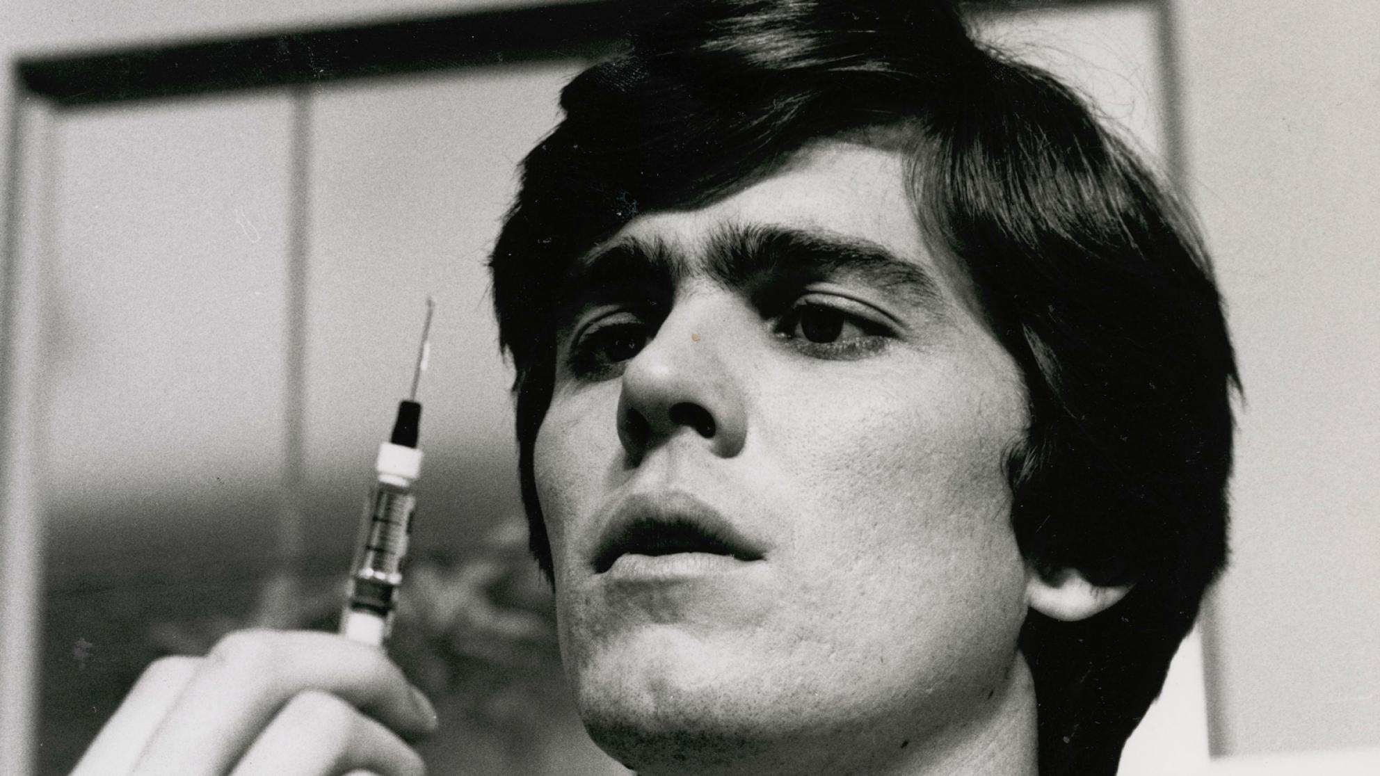 Mark Holden as Dr Greg Mason in The Young Doctors, pictured holding a syringe.