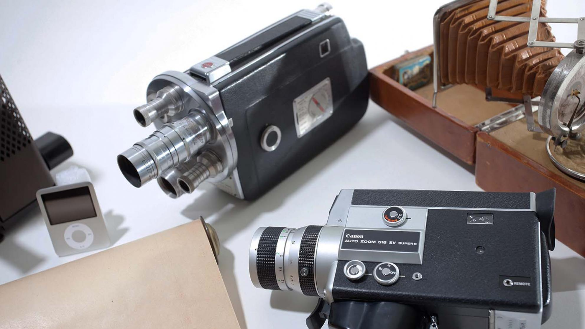 A variety of vintage camera and an ipod are displayed