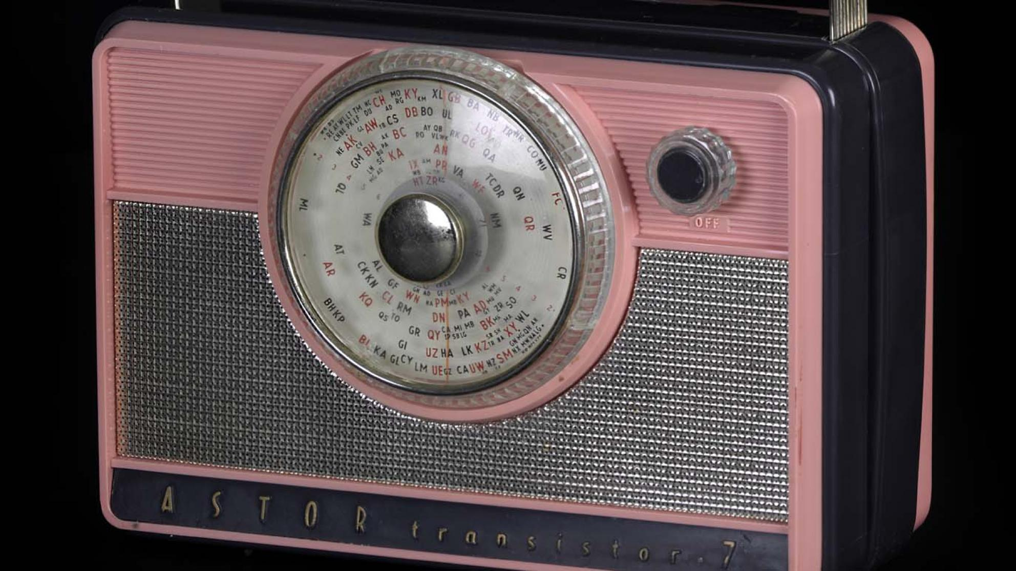 A pink and grey Astor 7 transistor radio from the 1950s or 1960s