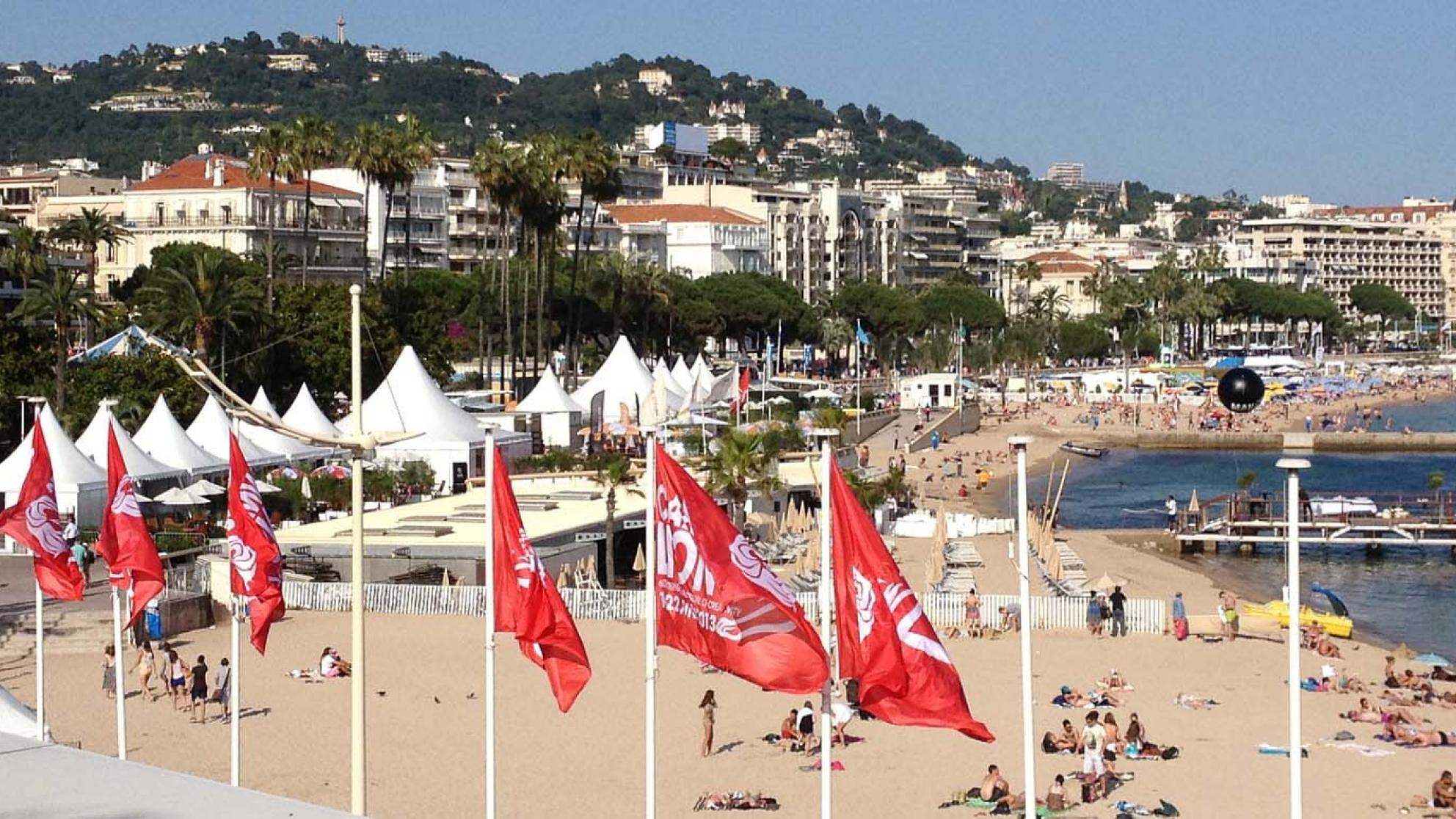 The beach front at Cannes with red flags in the foreground