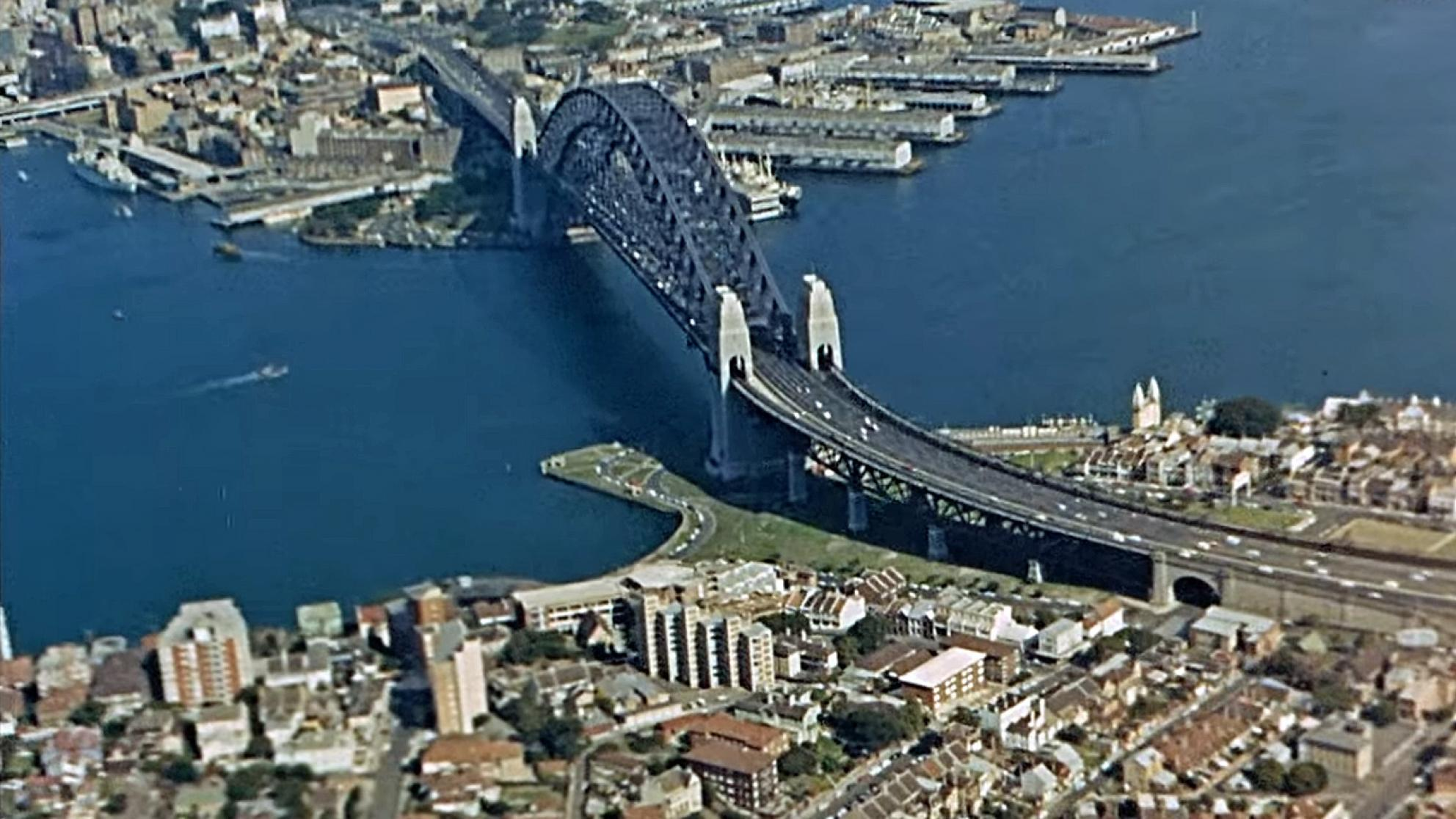 Aerial view of Sydney Harbour Bridge with Kirribilli and Milsons Point in the foreground and the Walsh Bay and Rocks area at the top of the image