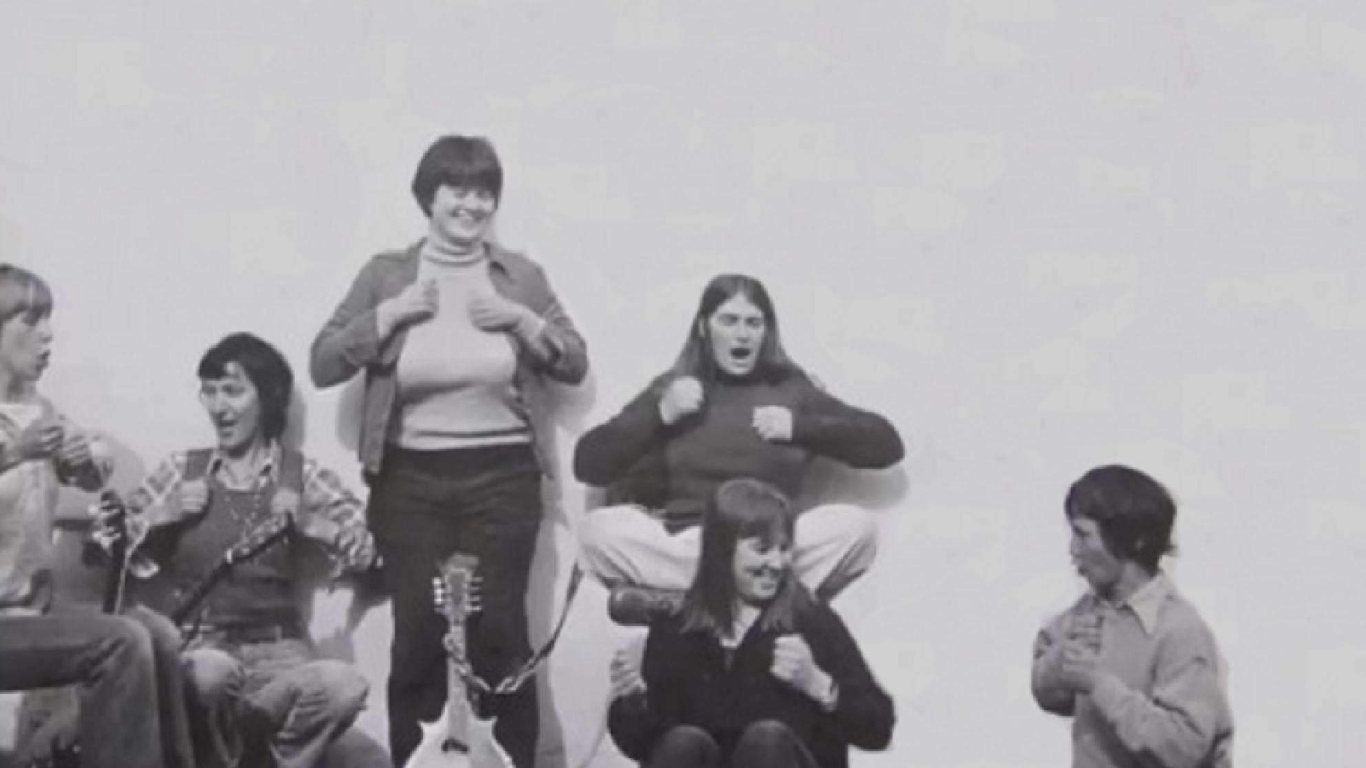 Six women posing for the cover of  The Ovarian Sisters' album. Black and white photo