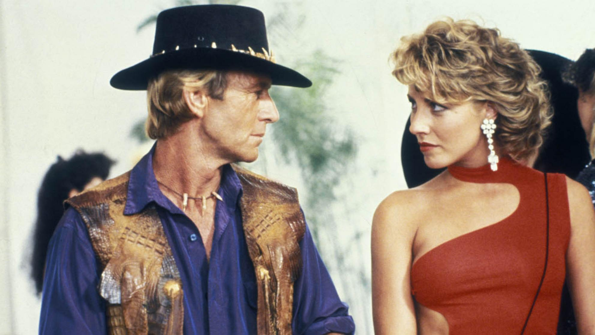 Paul Hogan looks at Linda Kozlowski in a still from the film Crocodile Dundee