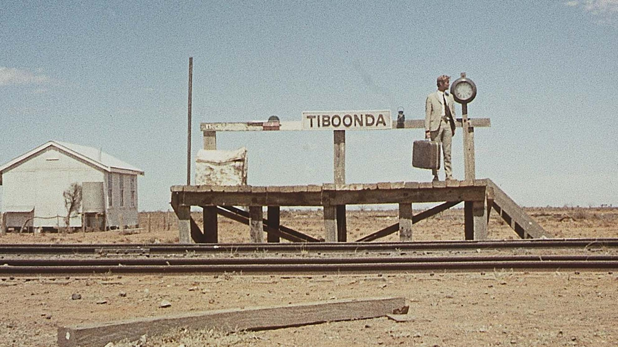 John Grant waits alone on an outback railway station platform in a still from the 1971 film Wake in Fright