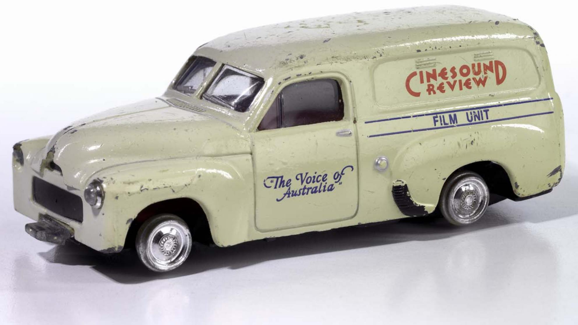 Die-cast scale model of a cream-coloured FJ Holden panel van used by Cinesound Review