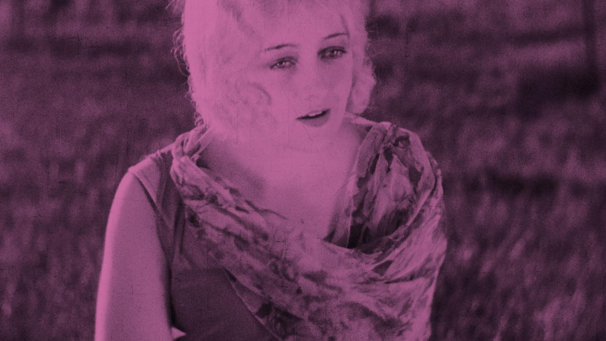 A rose-pink tinted image of a woman looking off into the distance.