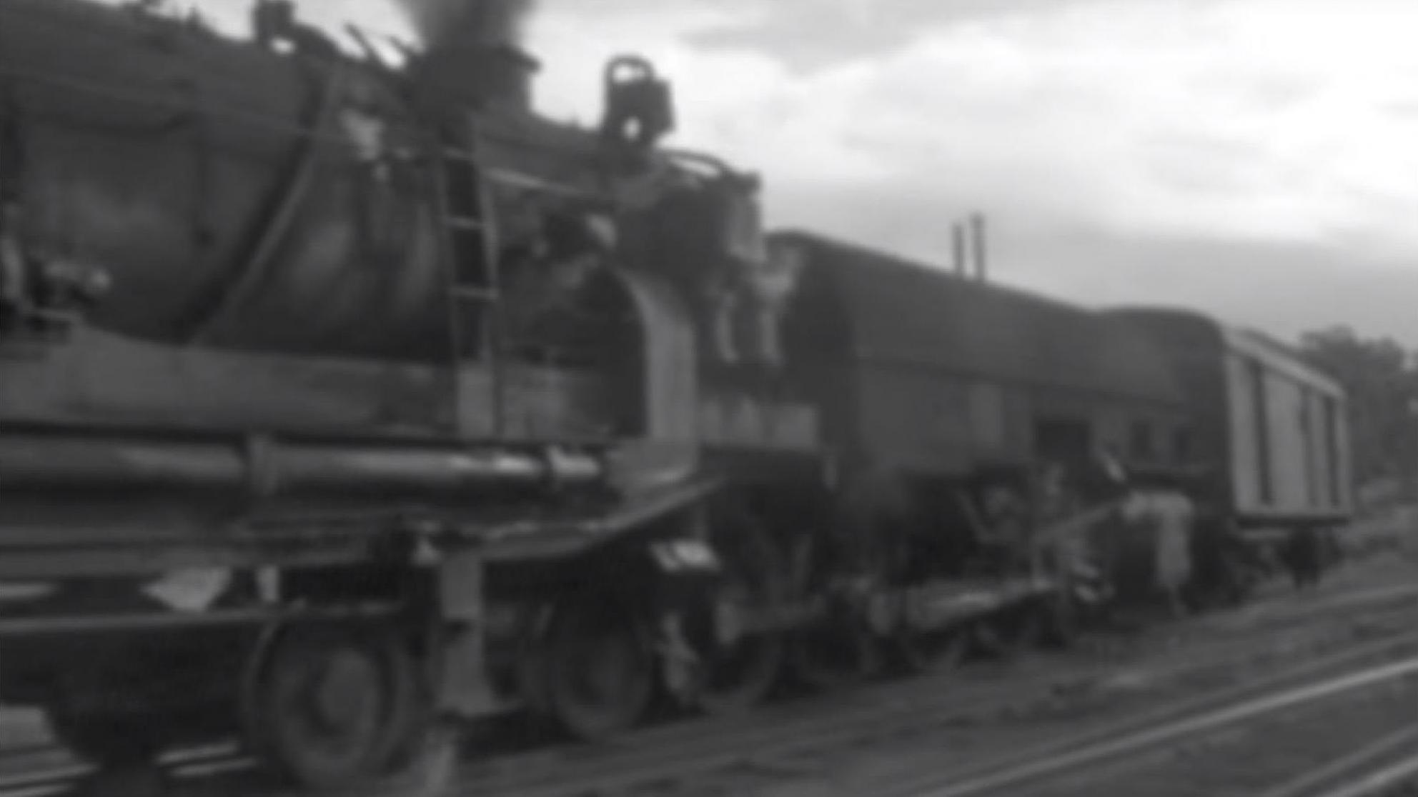 Screenshot of amateur black and white footage showing train passing in Newcastle, circa 1970s.