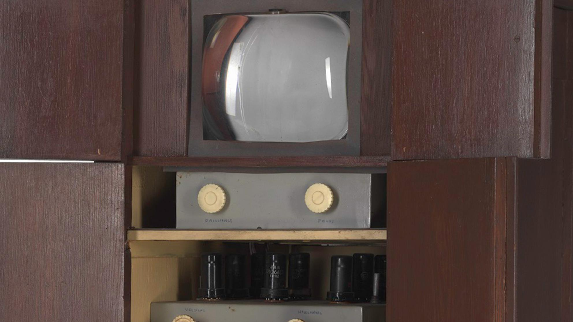 Close up of Sid Oldroyd's homemade TV showing screen and dials inside a wooden cabinet, built in 1956.