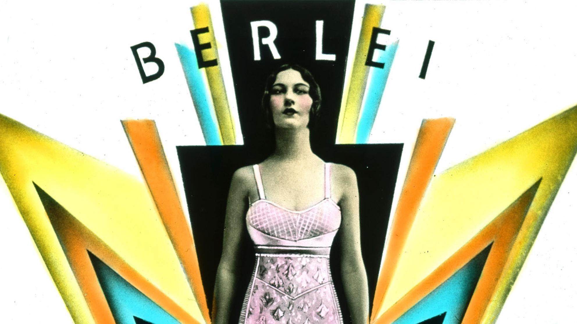 A woman wearing a pink foundation garment stands amidst art deco design elements suggesting power and lightening.