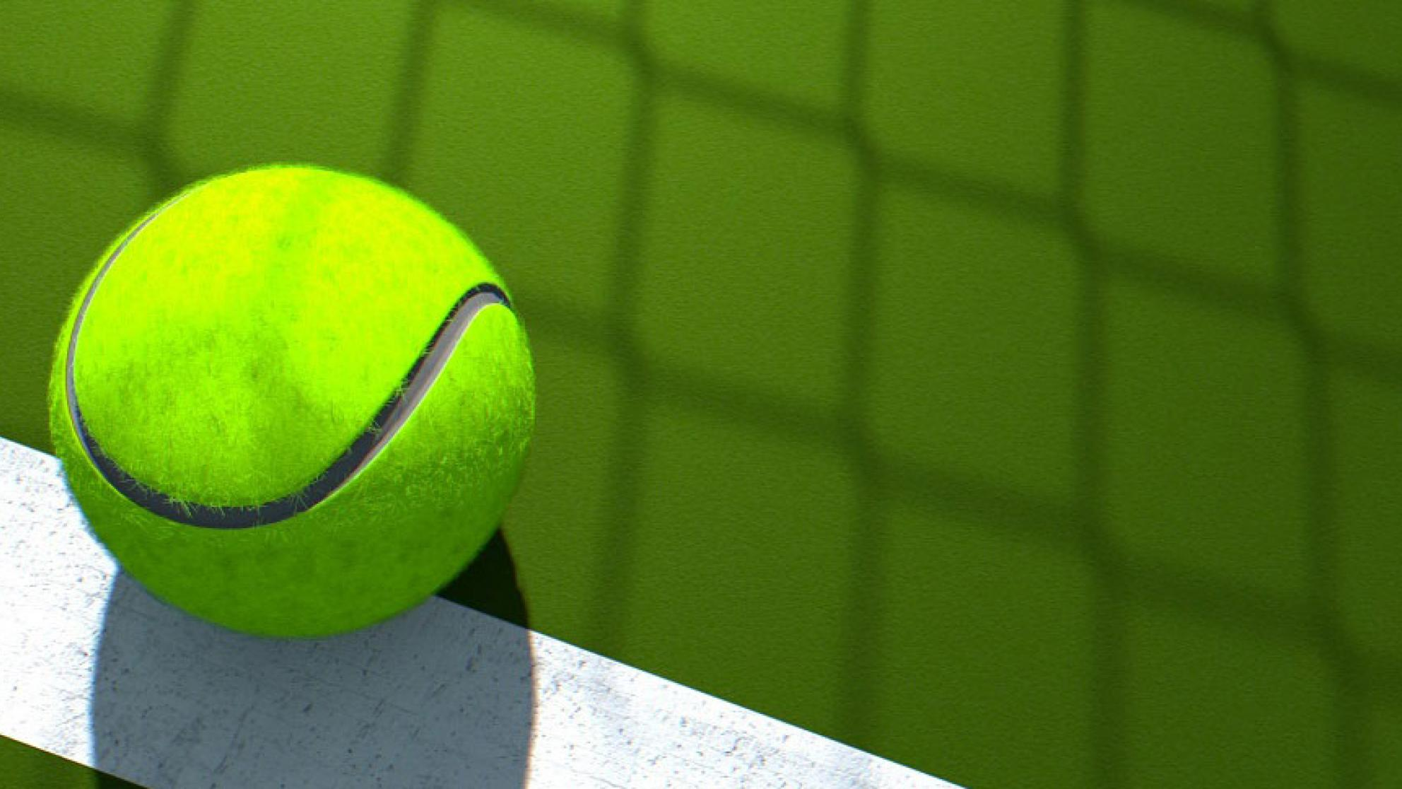 Close up of a tennis ball on a tennis court.