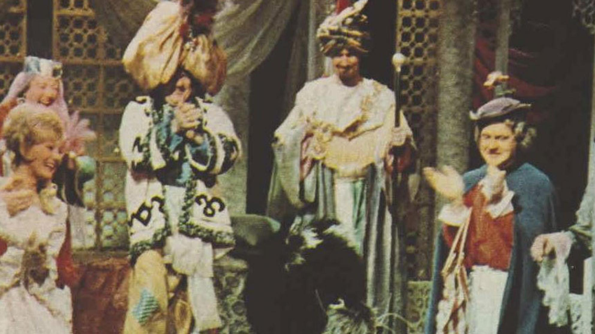 Costumed actors performing in the pantomime, Dick Whittington and His Cat