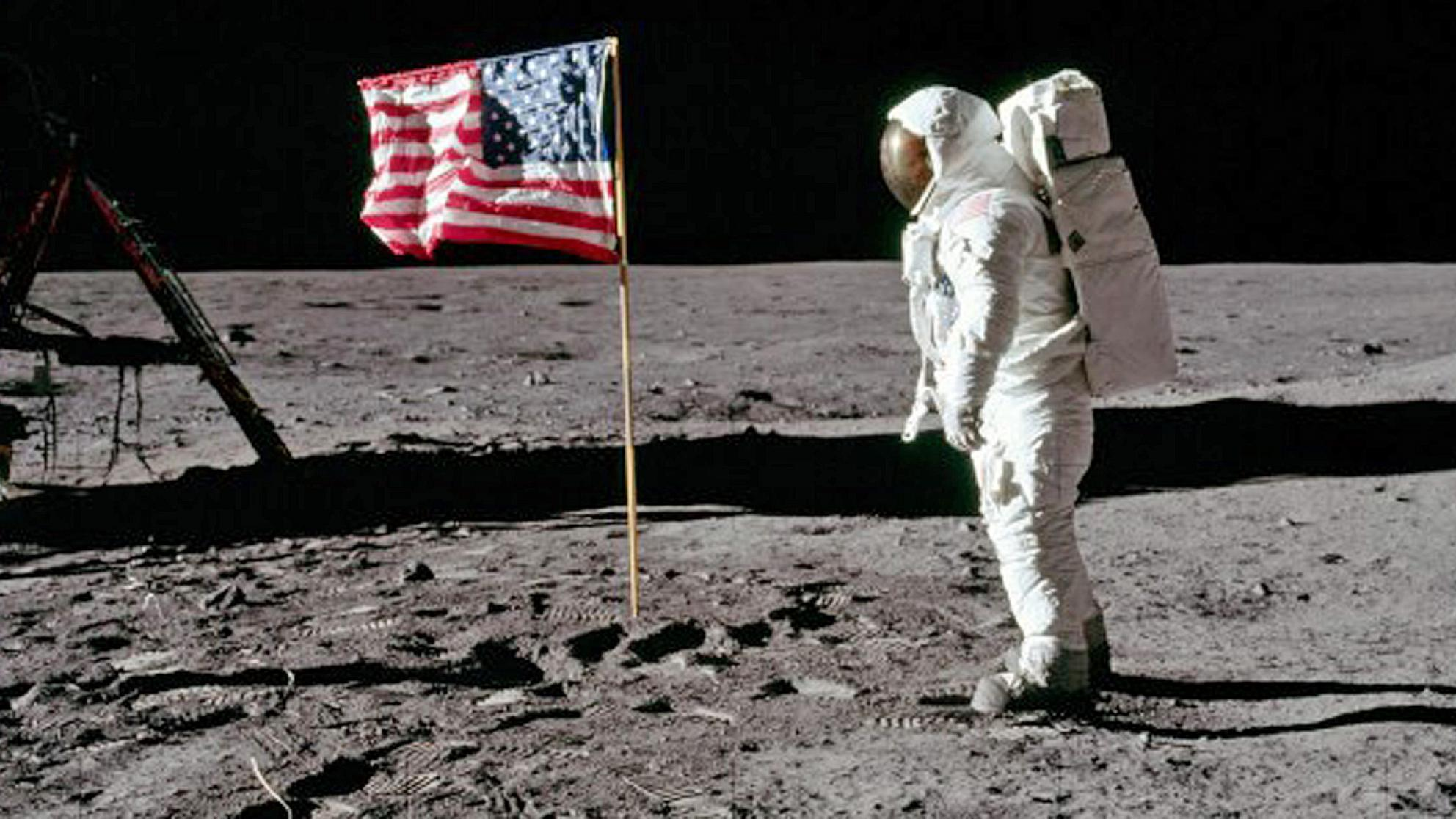 Astronaut on the moon standing near the American flag