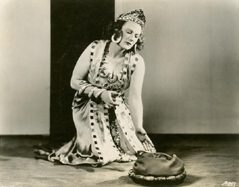 Marjorie Lawrence kneeling and dressed as Salome.