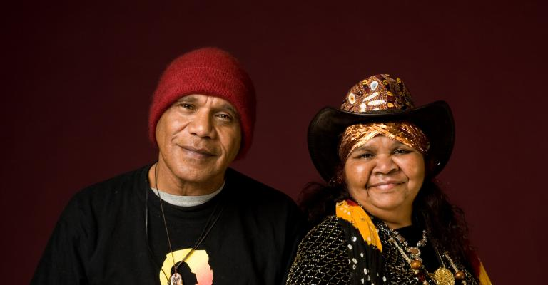 Archie Roach and Ruby Hunter smile for the camera.
