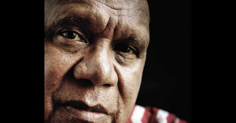 The front cover of Archie Roach's book 'Tell Me Why'. Features a close-up of Archie's face.