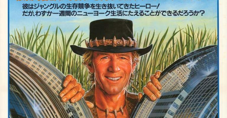 Japanese film poster for Crocodile Dundee showing Mick Dundee smiling as he parts New York City skyscrapers with his hands